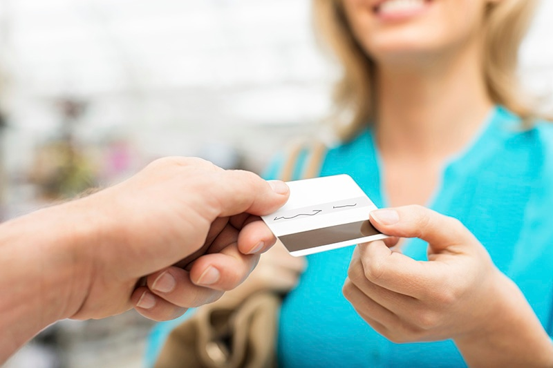 Woman paying with gift card